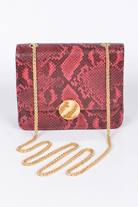 Animal Print Clutch With Circle Metal Detail